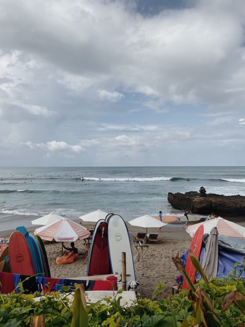 Watching surfers on the beach in Canggu